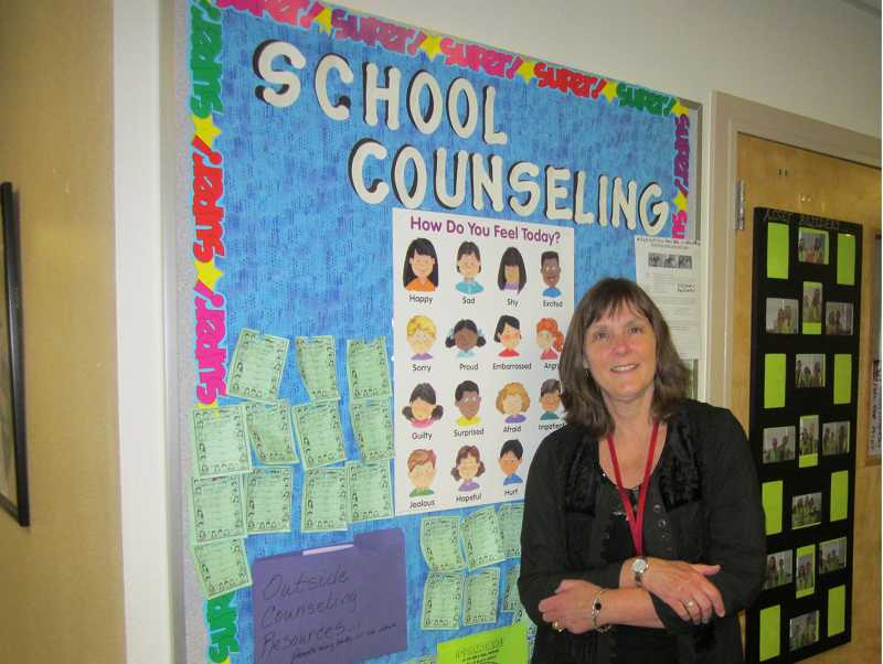 by: BARBARA SHERMAN - HEADING OUT - Kate Kelleher, the school counselor at Hopkins Elementary, stands outside her office, which she will leave for the last time in June after nearly 33 years in the Sherwood School District.