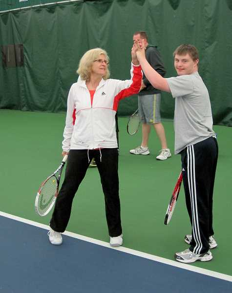 by: SUBMITTED - Gerri Allen, professional tennis coach at the Lake Oswego Indoor Tennis Center, gives a high-five to Daniel Tucker after a great shot at practice.