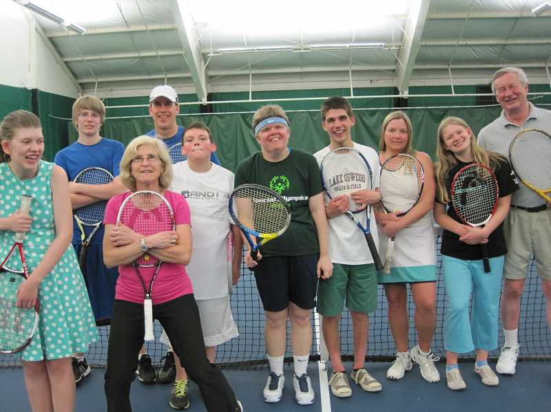 by: SUBMITTED - Coaches and players in the Special Olympics program at the Lake Oswego Indoor Tennis Center pose for a group photo. Gerri Allen, second from the left up front, is director of the program, now in its 10th year.