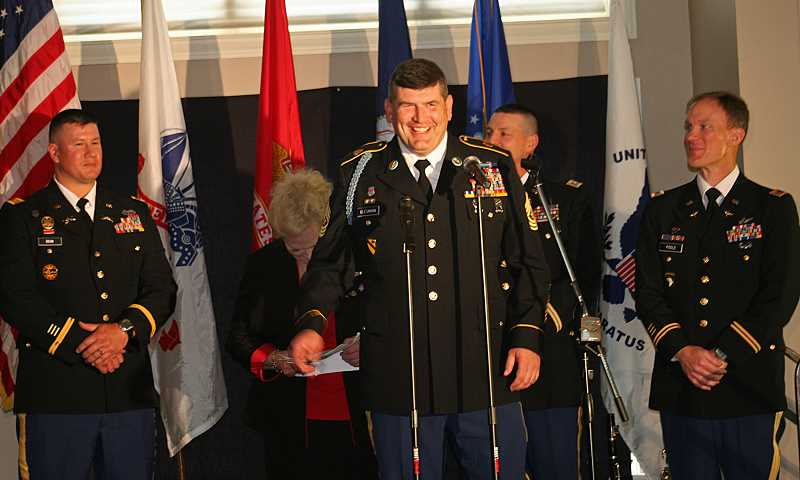 by: SUBMITTED - Sgt. Maj. Jerry Glassman, of the 82nd Brigade of the Oregon National Guard, takes center stage while being honored for his heroism at Tribute to Heroes.