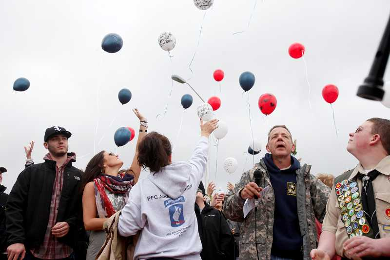 by: TIMES PHOTO: JONATHAN HOUSE - The Keller family releases balloons with messages for Andrew at the conclusion of a touching Memorial Day dedication ceremony on Monday afternoon.