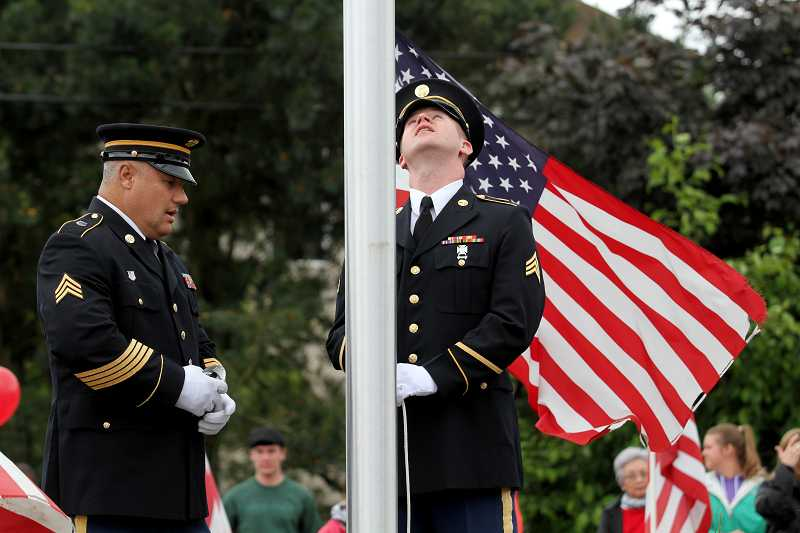 by: TIMES PHOTO: JONATHAN HOUSE - Oregon Army National Guard Sergeants Brett Roesch, left, and Jeff Robinson make preparations at the Andrew Keller Memorial Circle during a Memorial Day program honoring Army Pfc. Andrew Keller, who was killed in action while serving our country.