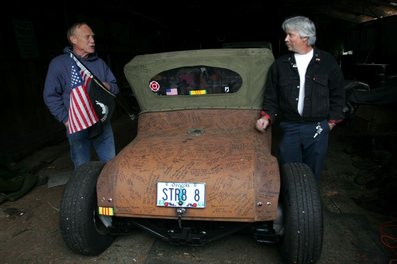 by: OUTLOOK PHOTO: JIM CLARK - Wayne Swanson, left, got help building his roadster from friend and fellow veteran Dana Price, who also is a Boring resident.