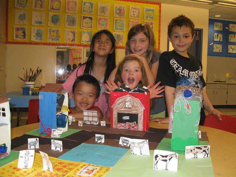 by: SUBMITTED PHOTO - First-graders, from left, (kneeling) Isaac Noesen, Tarin Buffington, (standing) Amelia Broyles, Alana Ryan and Damon Walls display their milk carton community.