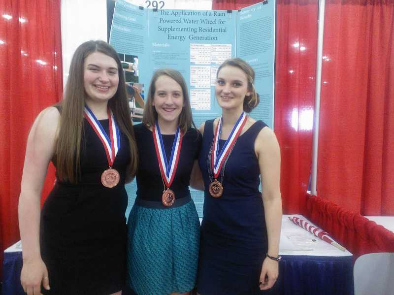 by: SUBMITTED PHOTO - Zoe Maxwell, Clara Altimus and Arianna Hall won a bronze award at the ISWEEEP competition in Houston on May 12.