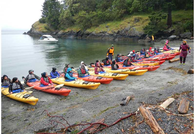by: CONTRIBUTED PHOTO: ANDY WEX - Sandy High School students prepare for a kayak trip in the San Juans on May 19. Thirty members of the Aquanauts science club took the trip to explore and experience marine life.