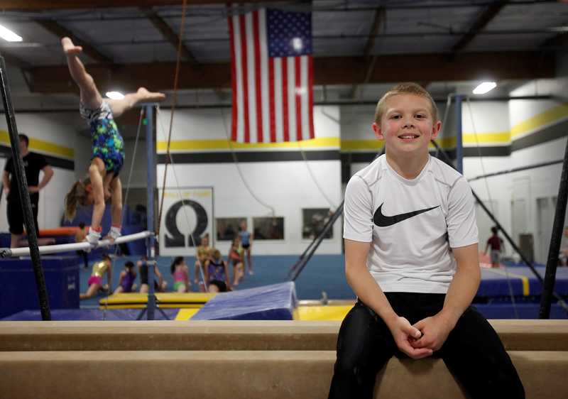 by: TIMES PHOTO: JONATHAN HOUSE - Spencer Goodell, 13, of Tigard, is the first Oregonian to make it to the USA Junior National gymnastics team. He plans to attend the 2016 games in Rio de Janeiro, Brazil.