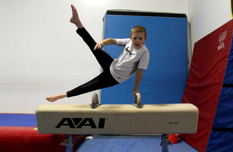 by: TIMES PHOTO: JONATHAN HOUSE - Spencer Goodell won fourth place on the pommel horse at the national championships held in Portland May 5. Goodell said the apparatus is his favorite, although it is traditionally one of the more difficult aparatus to master.