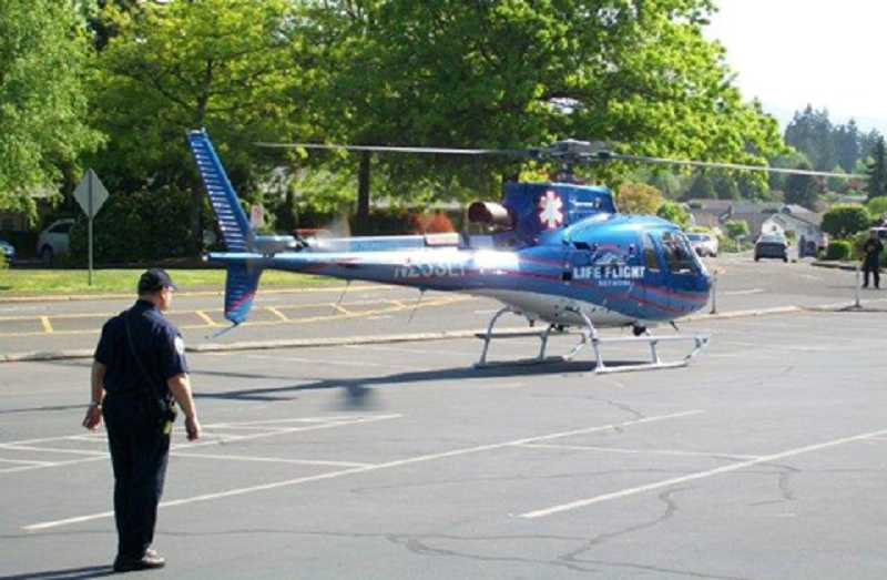 by: J. PATRICK MOORE - CLEAR THE DECK - King City officials only had a few minutes to prepare for a LifeFlight landing May 8 after a man was injured on Little Bull Mountain across Pacific Highway from King City.