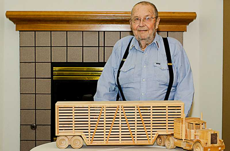 by: PHOTO CONTRIBUTED BY FLYNN PHILLIPS - Howard McMichael, the former mayor of Antelope, displays a scale truck model that took him 10 months to build.