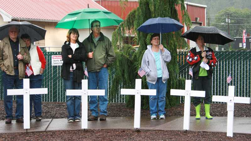 by: SANDRA HUNT - An estimated 60 people, including Estacada Mayor Brent Dodrill,  attended the ceremony.