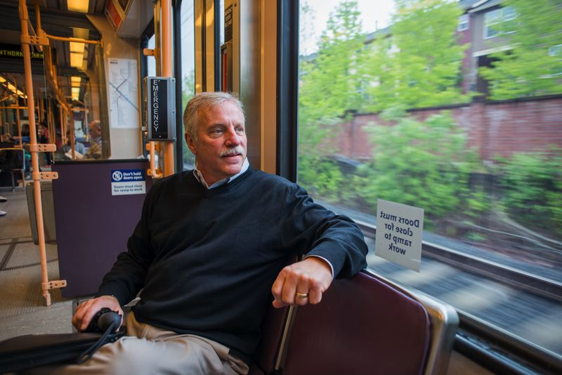 by: TRIBUNE PHOTO BY CHASE ALLGOOD - TriMet board president and Hillsboro resident Bruce Warner regular rides the MAX line from his home near Orenco Station to Portland.