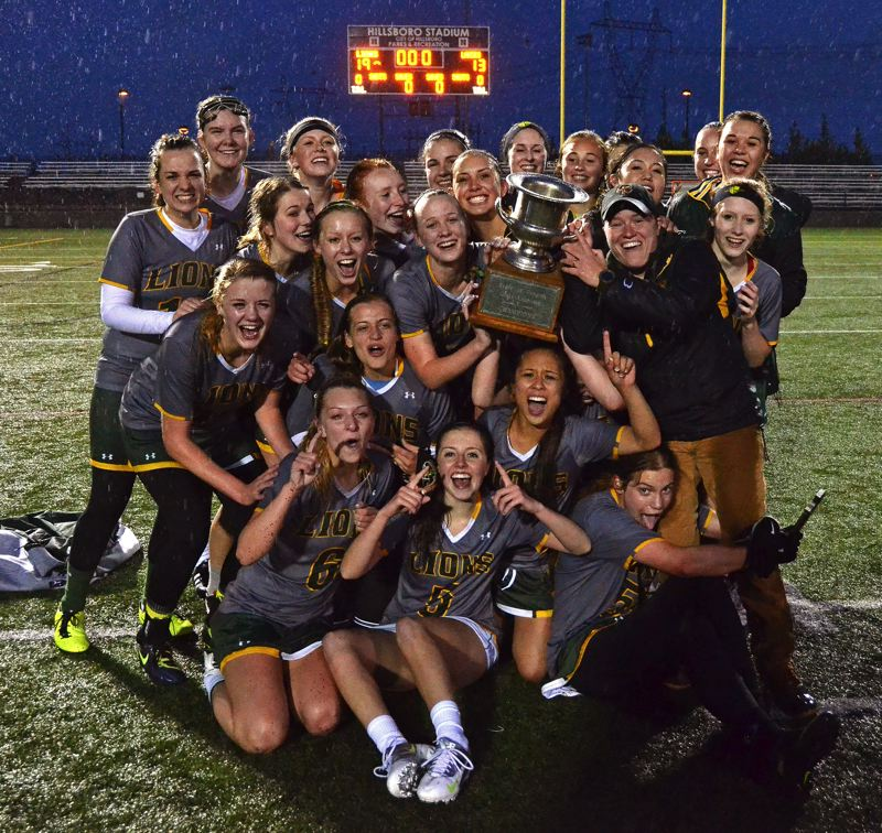 by: VERN UYETAKE - The West Linn girls lacrosse team poses with the state championship trophy after toppling Lake Oswego 19-13 at Hillsboro Stadium last week.