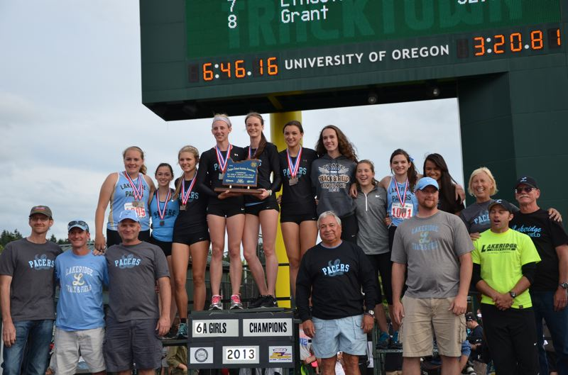 by: LYNDA O'NEILL - Members and coaches of the Lakeridge track team stand with their state championship trophy on the podium at Hayward Field last Saturday.