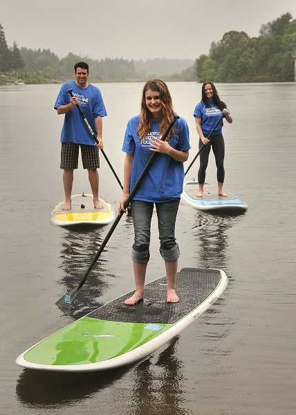 by: REVIEW PHOTO: VERN UYETAKE - The family that paddleboards together has fun together. From the left are Kevin, Hailey and Steph King. They are training for Stand Up to NF on Aug. 4.