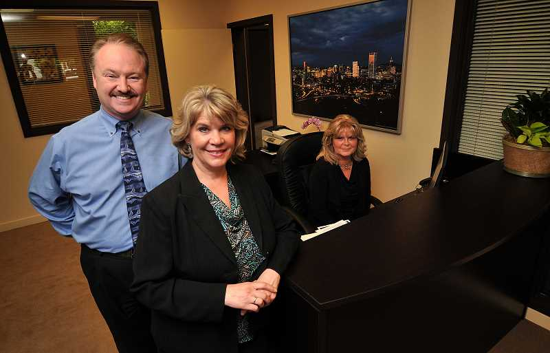 by: REVIEW PHOTOS: VERN UYETAKE - Lark Leitgeb and her husband, Sherman Leitgeb, have opened Equity Oregon, a new real estate office in Lake Oswego. A satellite office is located in Canby. In background is Ann Bias, one of the principal brokers at the firm.