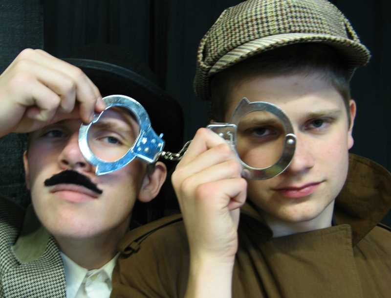 by: SUBMITTED PHOTO - Darden Harmon, left, as Dr. John Watson, and Austin Ellerbach as Sherlock Holmes appear in the acting clubs production of Holmes and Watson: A Question of Sanity.