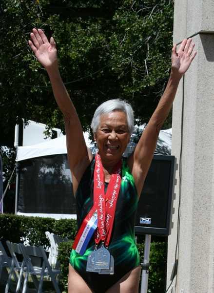 by: SUBMITTED PHOTOS - Flora Wong took up competitive swimming and running when she retired. At 85 she still runs competitively.