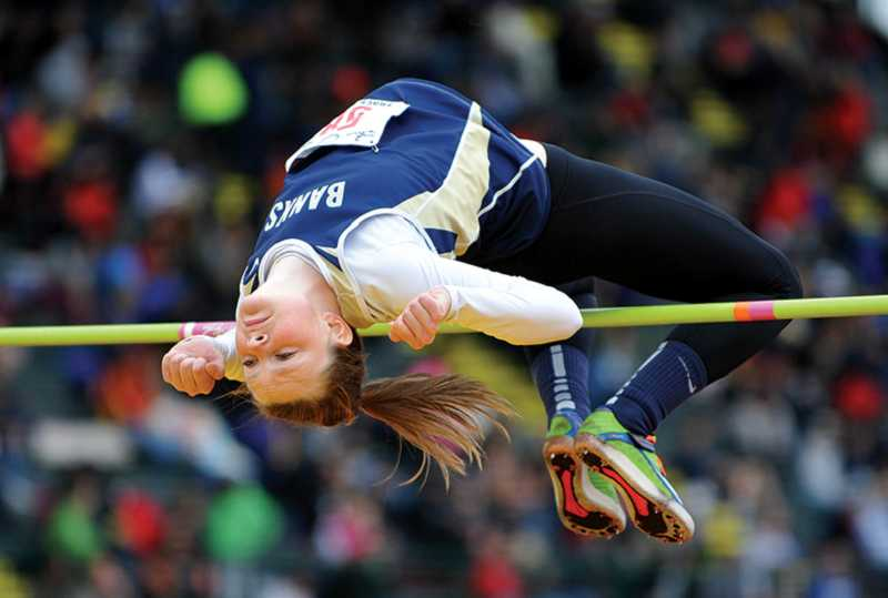 by: NEWS-TIMES PHOTO: ZACK PALMER - Banks junior Amy Hilger clears 5 feet, 2 inches en route to a second-place finish in the girls high jump at the Class 4A state track and field meet on Friday at Hayward Field in Eugene.