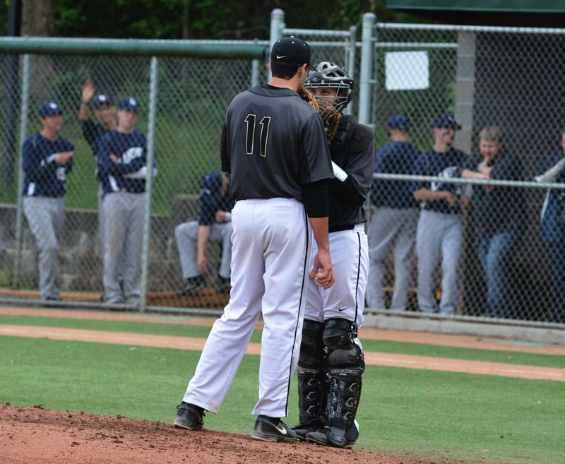 by: TIMES PHOTO: MATT SINGLEDECKER - Southridge catcher Tanner Green and pitcher Reza Aleaziz talk about how to attack Lake Oswego in the fourth inning of the Skyhawks 2-1 quarterfinal win.