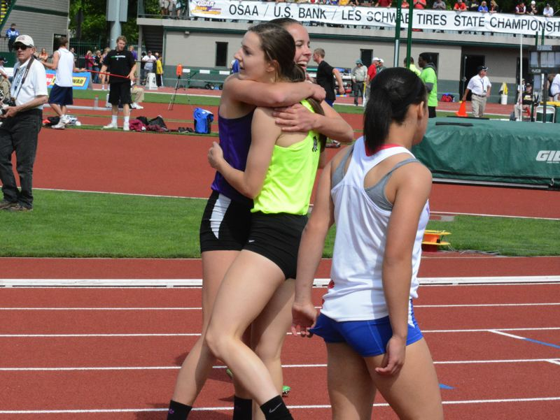 by: TIMES PHOTO: MATT SINGLEDECKER - Sunset junior Taylor Coon hugs Jesuits Alexa Dixon after winning the 200 at the 6A State Championships on Saturday.