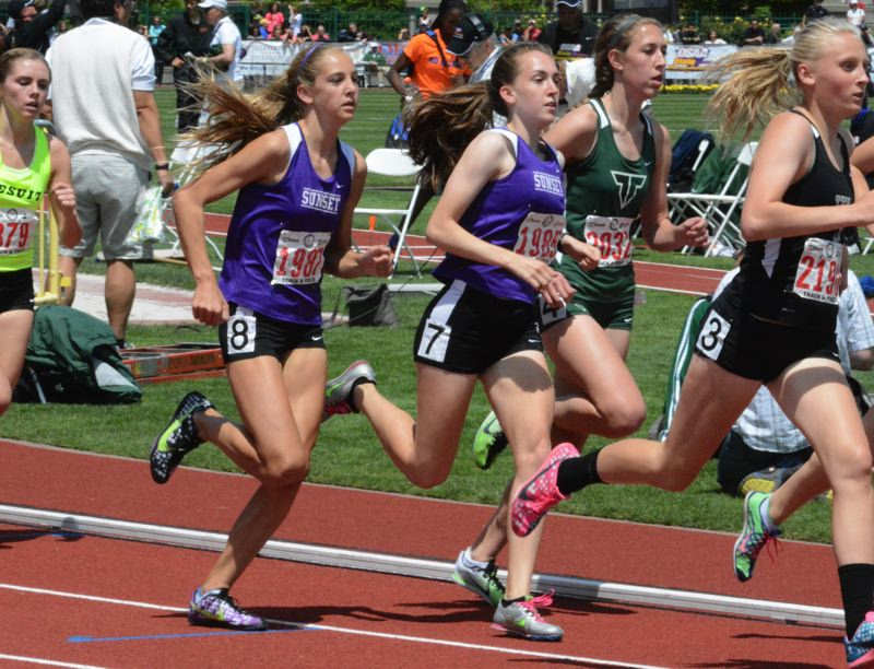by: TIMES PHOTO: MATT SINGLEDECKER - Sunset freshman Nicole Griffiths (left) and senior Sara Fahmy (right) battle it out in the 6A 1,500 final at Hayward Field on Saturday. Griffiths took seventh, and Fahmy was ninth.