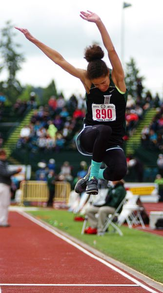 by: TIMES PHOTO: JOHNATHAN HOUSE  - Jesuit freshman Hadley Wilhoite competes in the long jump competition Friday at the Class 6A state meet. Wilhoite triumphed in Saturdays triple jump event.