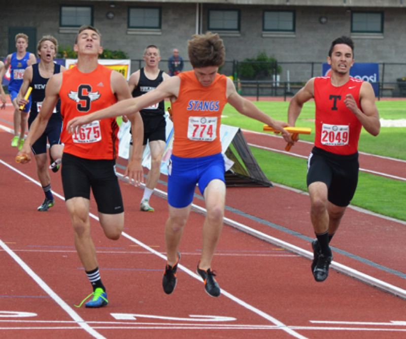 by: JOHN BREWINGTON - Scappoose's Justice Oman just about brought home a second state title in the 4x400 relay, finishing the anchor leg behind Hunter Tillery of Hidden Valley. Markus Pullen of Tillamook came in third.