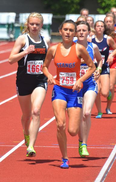 by: JOHN BREWINGTON - Scappoose's Charlie Davidson ran right on the shoulder of Hidden Valley's Sierra Brown during the 1,500 but couldn't out kick her to the finish.