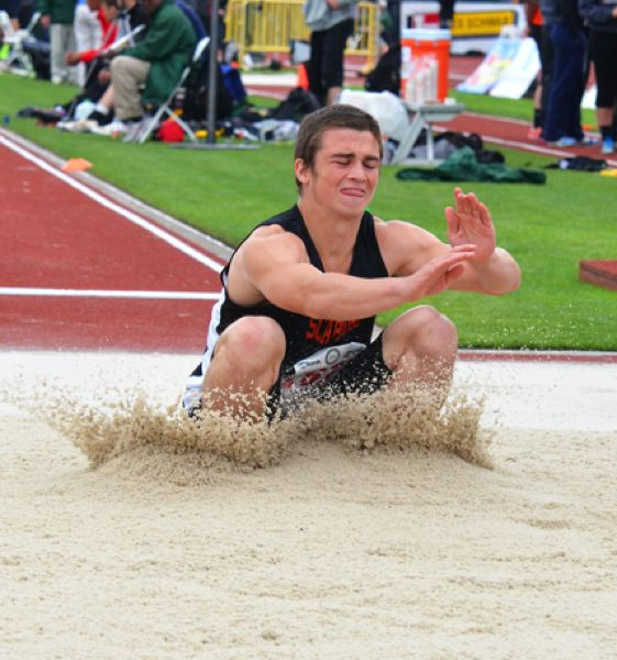 by: JOHN BREWINGTON - The Tribe's Paul Revis had a good effort and placed eighth in the long jump.