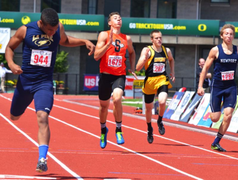 by: JOHN BREWINGTON - The Tribe's Justice Oman (in orange) finished second in 400 meter run at the 4A state meet.