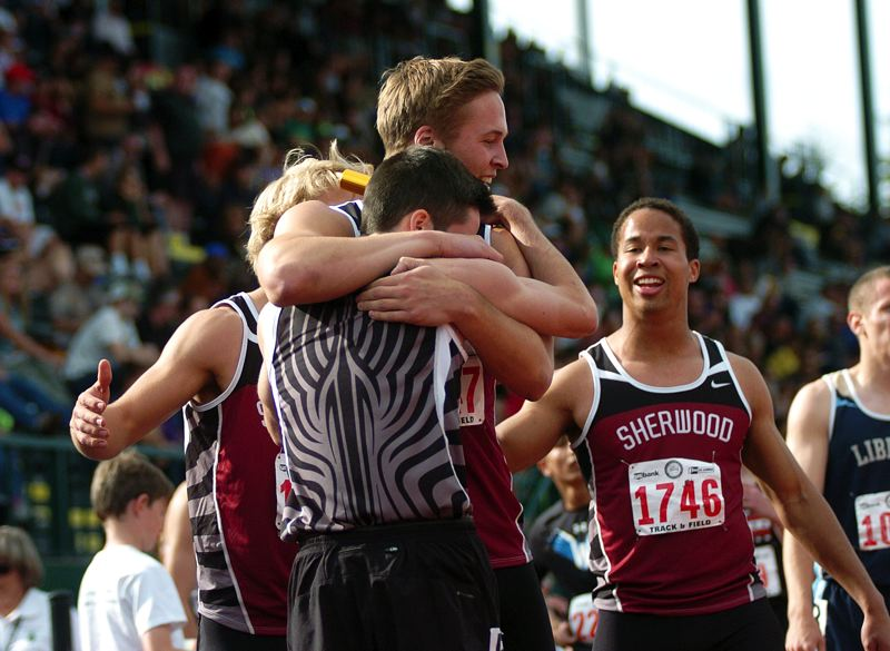 by: DAN BROOD - WE DID IT -- Sherwood's (from left) Emil Eriksson, Hunter Pfefferkorn, Cole Nixon and Cristian Morris celebrate following their winning performance in the 4 x 400 relay Saturday at the Class 5A state meet.