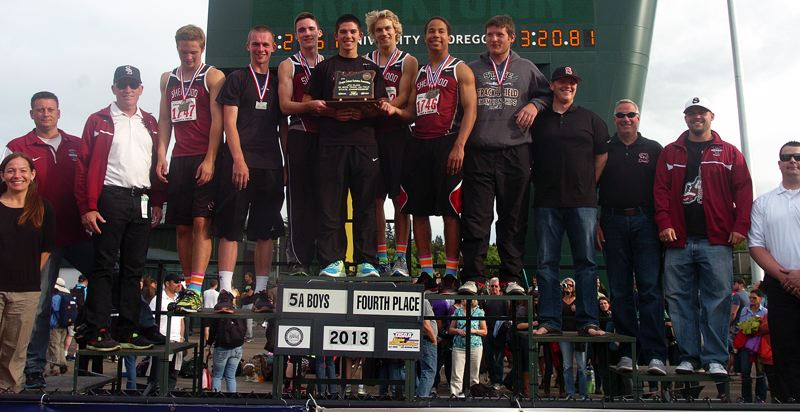 by: DAN BROOD - TROPHY TIME -- The Sherwood High School boys track and field team claimed the fourth-place trophy at the state meet.