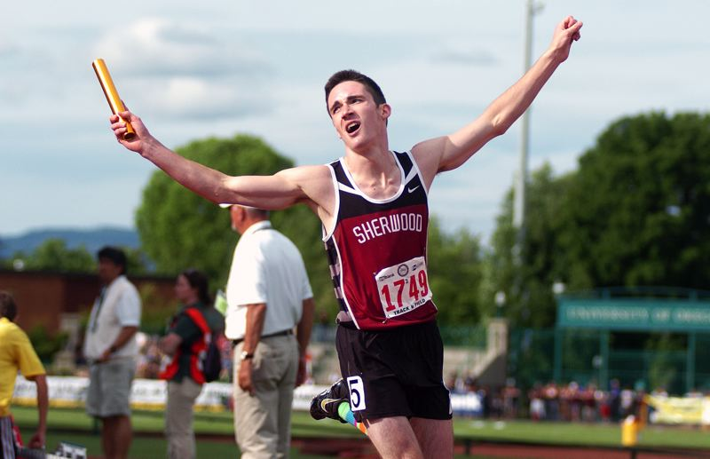 by: DAN BROOD - VICTORY-- Sherwood junior Hunter Pfefferkorn celebrates after the Bowmen won the 4 x 400 relay.