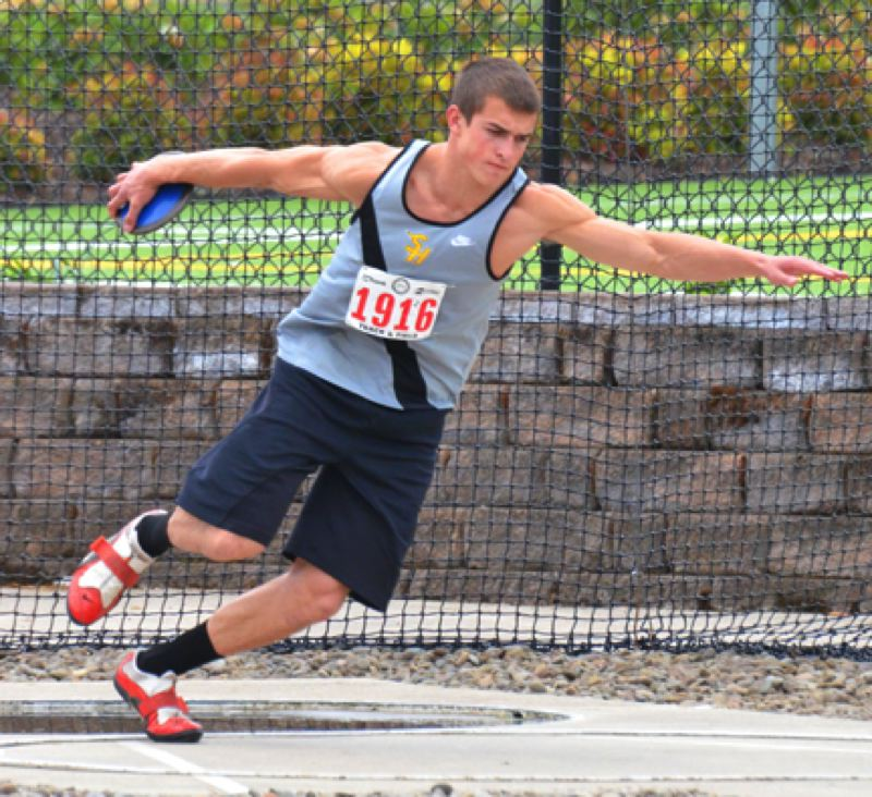 by: JOHN BREWINGTON - St. Helens' Nate Reed took fourth place in the discus, and eighth in the javelin, despite a sore arm at the 5A state track meet.
