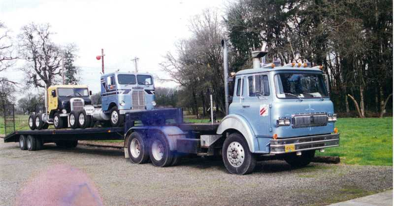 by: COURTESY OF JOYCE SAARI - TRUCK TIME -Three of Joyce and Del Hewitt's trucks are on the move in 1995 and became part of the Pacific Northwest Truck Museum that they co-founded with with four other people in Brooks.