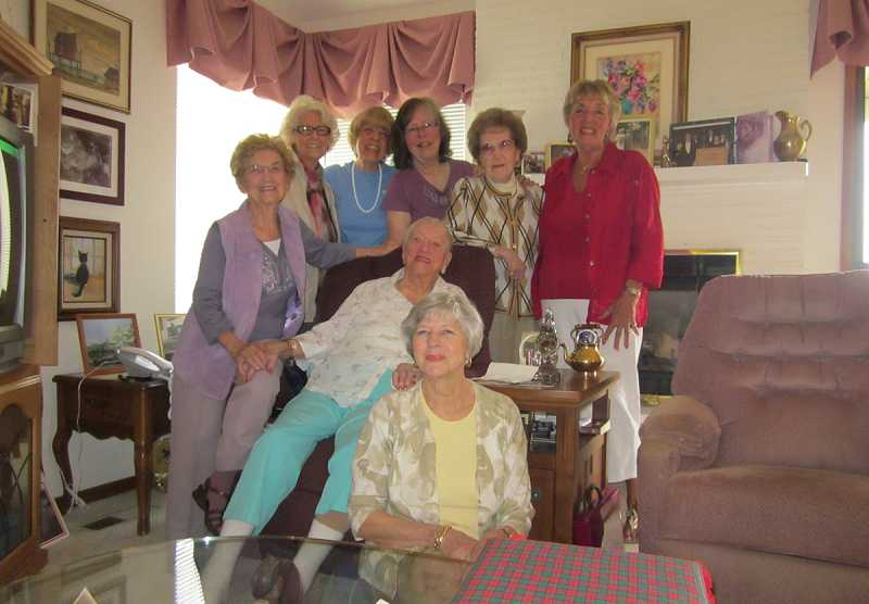 by: BARBARA SHERMAN - LAUGHTER THROUGH THE YEARS - Standing behind Elsie Battaglia are (from left) Joyce Saari, Ruth Lehman, Claudia Carlson, Char Heinrich, Hylda Rust and Alice Furey, with Georgia Meshke sitting in front of her.