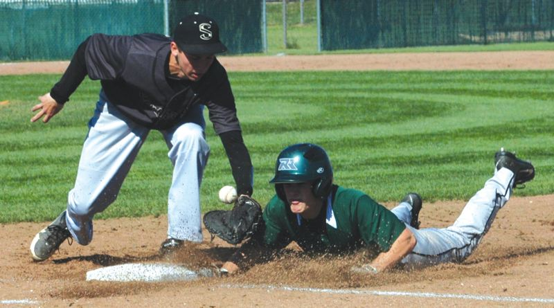 by: THE OUTLOOK: PARKER LEE - Reynolds Jake Erdman dives back to first base under the glove of Southridge first baseman David Knudsen. Erdman was called out on the play despite appearing to touch in under the tag.