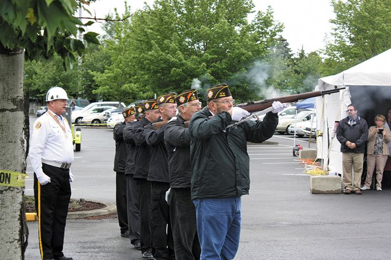 by: HILLSBORO TRIBUNE PHOTO: DOUG BURKHARDT - An honor guard comprised of members of the Veterans of Foreign Wars Post No. 2666 in Hillsboro fires volleys in a 21-gun salute to those who perished while in service in the nations military.