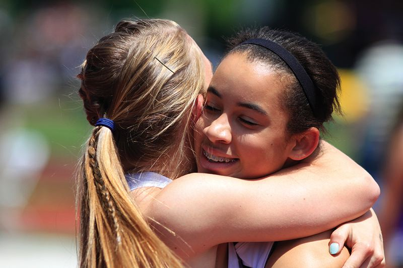 by: HILLSBORO TRIBUNE PHOTO: AMANDA MILES - Hillsboro freshman Alyssa Thomas (right) hugs teammate Anna Dean after the pair helped set a school record in the 4x100-meter relay on Saturday at the state meet.