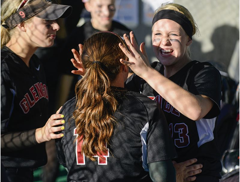 by: HILLSBORO TRIBUNE PHOTO: CHASE ALLGOOD - Glencoe senior Katie Sutherland-Finch celebrates with teammate Kylie Surratt during last Friday's 3-0 win over league rival Tualatin in the Class 6A state quarterfinals.