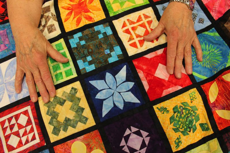 by: OUTLOOK PHOTO: CARI HACHMANN - A retired surgical technician, Karen Jordan stitched more than 200 square blocks by hand, each with its own colorful geometric design.