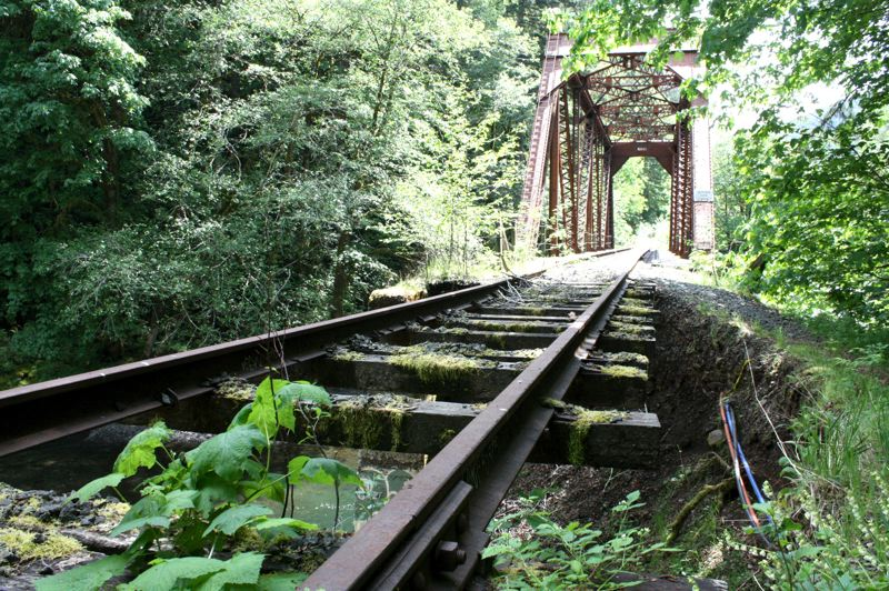 by: SPOTLIGHT PHOTO: KATIE WILSON - A bridge spans the Salmonberry River not far from the confluence with the Nehalem River. The rail line, which has not been in use since it suffered extensive damage in the storm of December 2007, is being eyed for trail development.