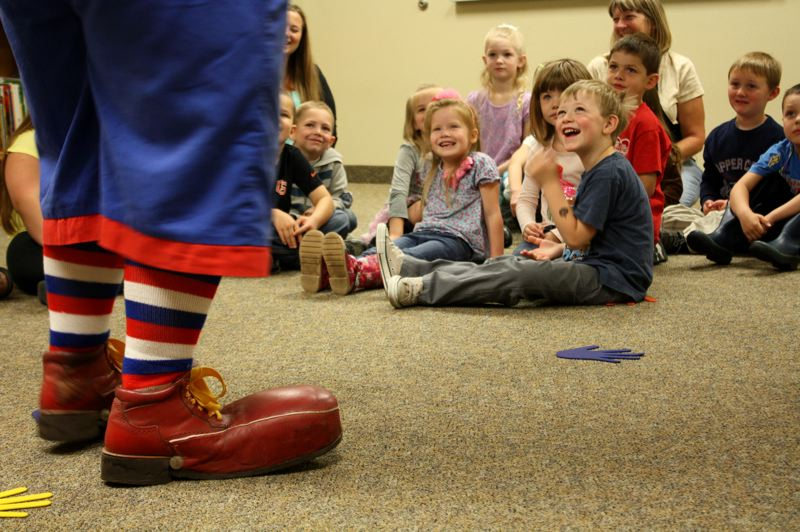 by: SPOTLIGHT PHOTO: KATIE WILSON - A class at the Lil Learners preschool in Grace Christian Church in St. Helens giggles at Skeeter the Clowns antics May 24.
