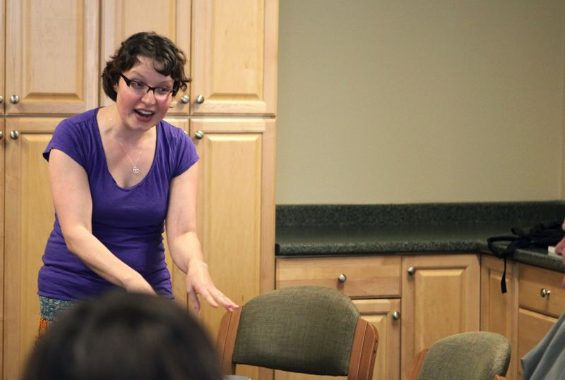 by: PHOTO BY: KONSTANTIN MOSKALENKO - Well Arts Institute founder and writing-for-theater workshop leader Katy Liljehom is facilitating the beginning of the writing session, when there are 10 minutes of exercises writing prompts that help the group get started. Sometimes it is a list of words, or music, quotes from famous novelists or poetry.