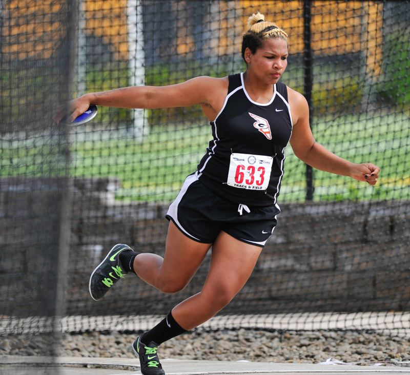 by: BY JOHN LARIVIERE - Gladstone High School senior Donna Robinson made it a three-peat at the recent Class 4A State Track and Field Championships, winning the discus for a third consecutive year.