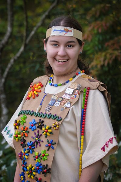 by: PHOTO COURTESY: CAMP FIRE - Erin David is pictured wearing her Camp Fire ceremonial attire. Through the organizations programs, she had to earn every patch, and even every bead, on the vest.
