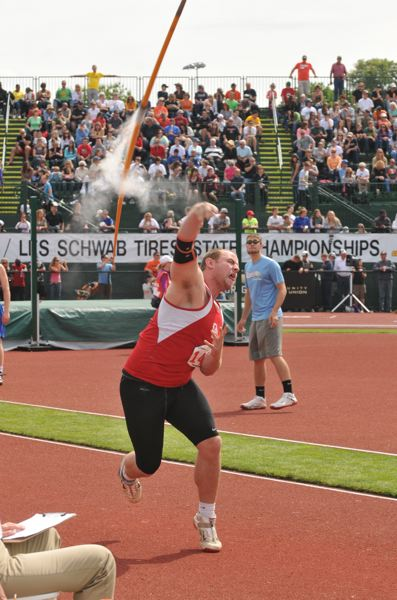 by: SETH GORDON - Oregon City senior Beau Brosseau launches the javelin at the 2013 Class 6A State High School Track and Field Championships.