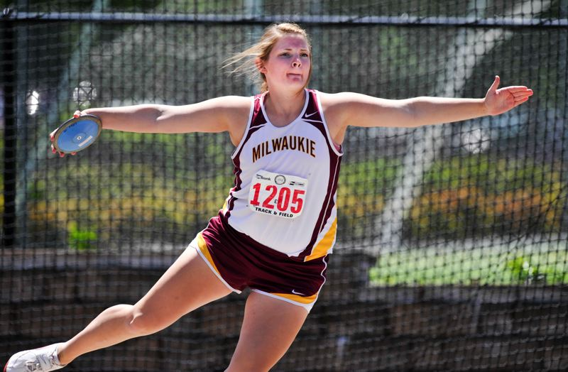 by: JOHN LARIVIERE - Kayler Hammond-Stief competes in the discus at the 2013 Class 5A State Championship Track and Field Meet. The Milwaukie High School junior improved upon her personal best by close to 10 feet and was a surprise state champion in the event.