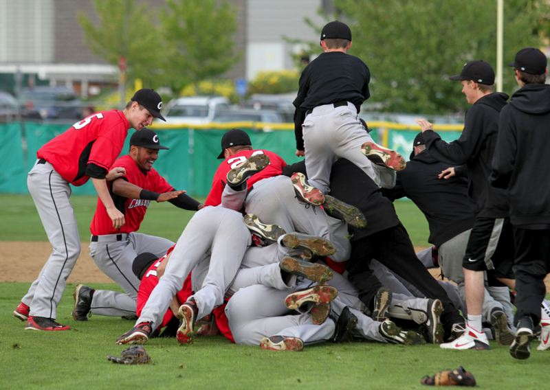 by: JONATHAN HOUSE - Clackamas players celebrate their come-from-behind, extra-inning semifinal victory over Southridge.